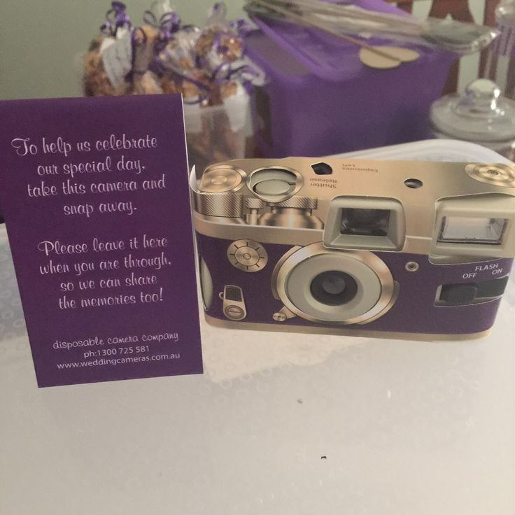 Retro purple disposable Camera we had on each of the tables for guest to snap away