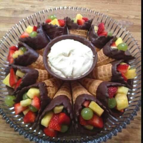 Great idea for a shower or birthday party chocolate dipped waffle cones with fruit in it with fruit dip in a chocolate dipped waffle bowl. It makes life easier when all dishes are edible. (eat fruit healthy)
