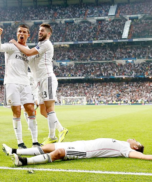 Ronaldo and Isco celebrate. Chicharito lies there. He's tired. Advancing to the Champions League semis is a big deal. #halamadrid