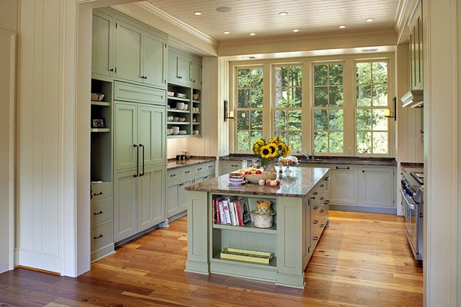 Great open shelving, built-in fridge; beadboard ceiling. Love the pale green and yellow colors in the kitchen. Great windows, too.