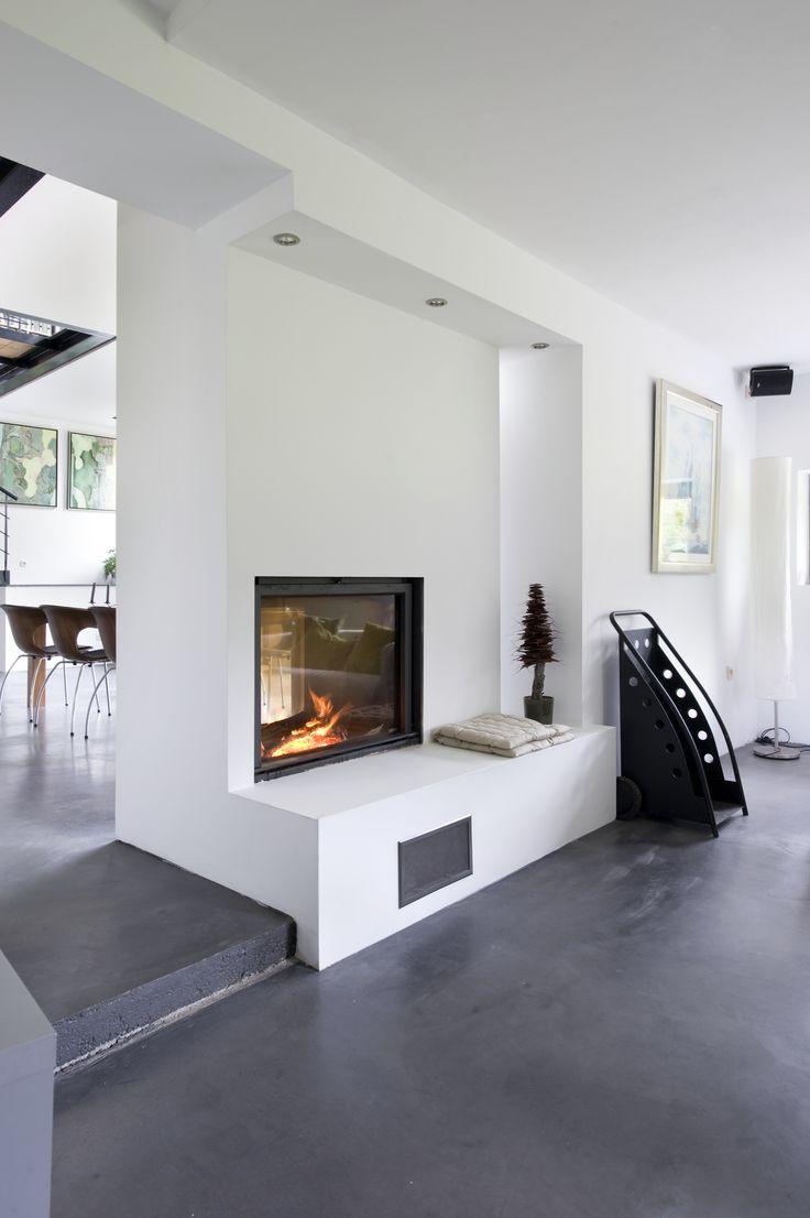 STUV #foyerbois double-face. #Foyerencastrable sobre et épurée complètement intégrée à l'architecture qui ne laissent que la vision du feu.