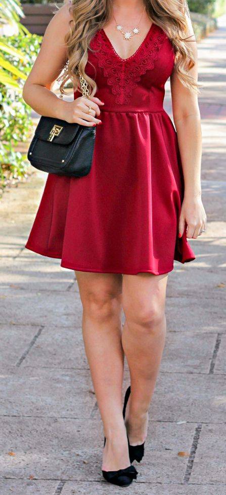 Beautiful @shoppinkblush red dress with embellished neckline, @LCLaurenConrad starburst necklace, @luxyhair dirty blonde extensions, Sears Style black and gold purse, @justfabonline black bow heels, and Kate Spade bow ring styled in a date night outfit idea by blogger Ashley Brooke Nicholas. Click through this pin to see the full look + learn where you can buy each item