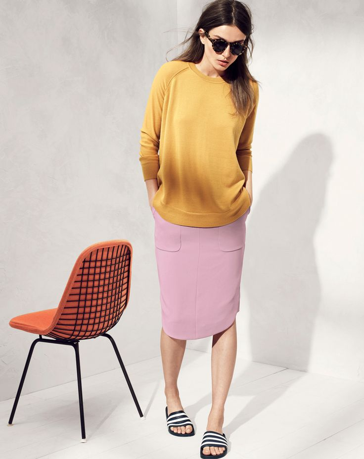 J.Crew women's merino swing sweater, and crepe shirttail skirt. Those shoes look awful though. wth