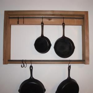 Free woodworking plans to build a rustic pot rack, ideal for hanging up to ten cast iron pots and pans. Download the free woodworking plans today!