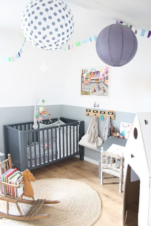 This airy gray nursery is the perfect backdrop to artwork and toys. #nurseryideas #paperlanterns #nursery