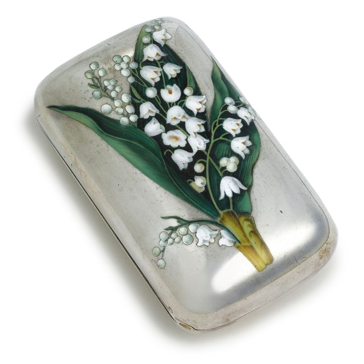 A Russian silver and enamel cigarette case, Klebnikov, Moscow, 1875, rounded rectangular form, the cover champlevé enameled with a spray of lilies of the valley, the base engraved with contemporary interlace cypher below a plumed helmet.