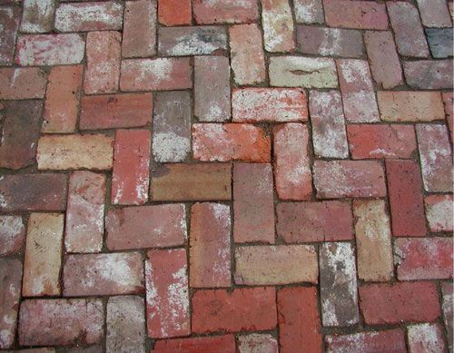 Old Tuscany Pavers.  Offering maximum color variation and textural interest, Old Tuscany paver bricks create a dramatic effect in shades of orange, rose, red and purple with white mortar stains for even more contrast. No two are exactly alike, and no other home will look exactly like yours.