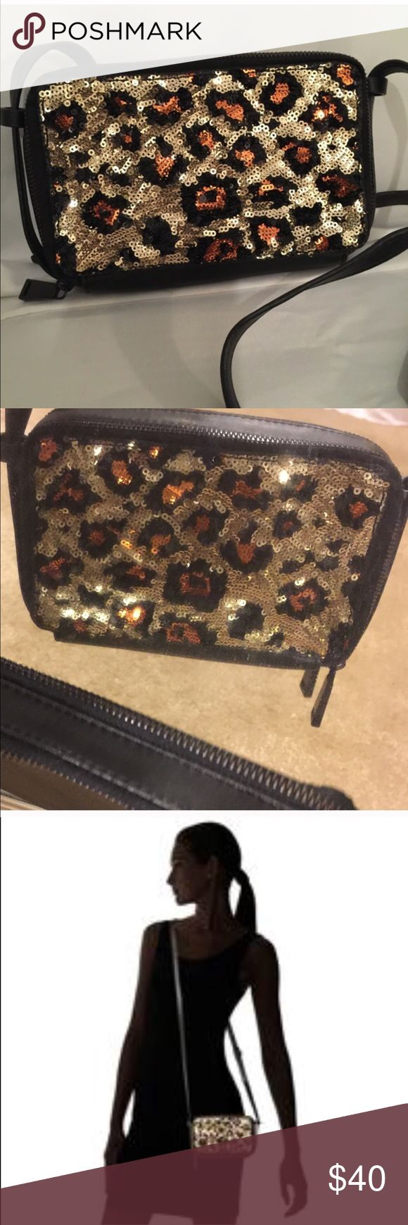New French Connection Sequin Purse Glamorous Cross Body made by French Connection. Leopard sequin on the front. A bag that sparkles.  Zip closure. Adjustable body strap. 2 interior pockets. 10 credit card holders. French Connection logo on the back. 6WX 1 3/4DX4H✅Price firm ✅ French Connection Bags