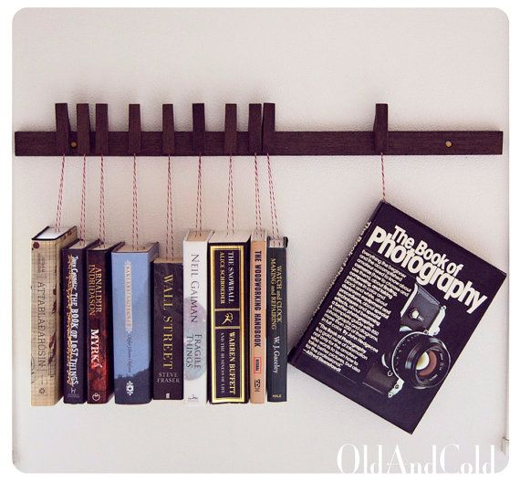 Custom made wooden book rack. Movable pins.The pins also work as bookmarks.