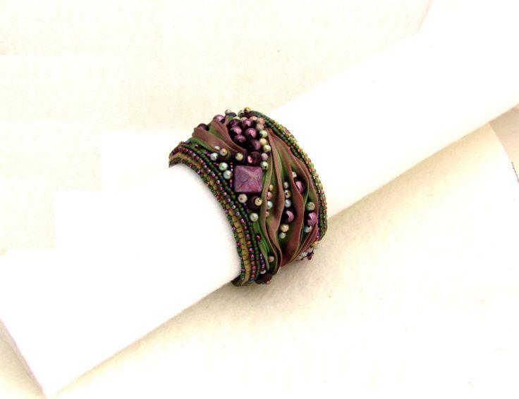 Shibori silk cuff bracelet, Bead Embroidery Cuff Shibori Silk Ribbon, Shibori Bracelet Cuff, Unique multicolored boho bracelet Secret Garden by CraftNicheDili on Etsy https://www.etsy.com/listing/258507097/shibori-silk-cuff-bracelet-bead
