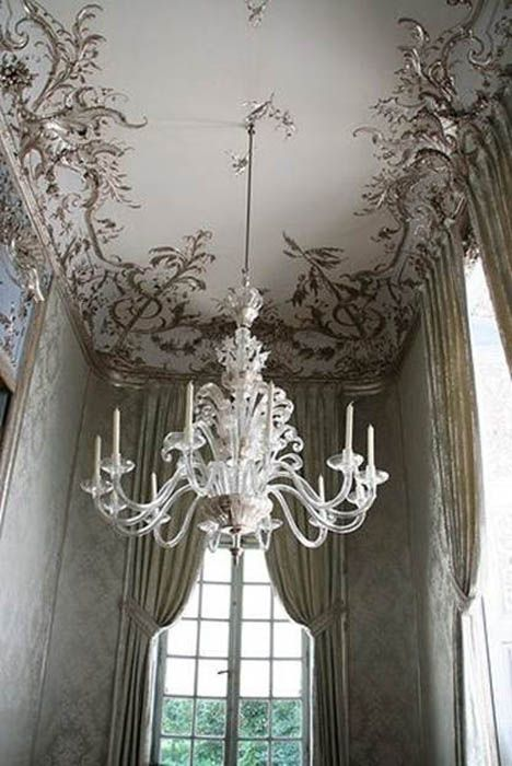 With its intricately applied plaster moldings, this spectacular ceiling's details were gilded in silver, bringing the wallpaper and fabric tones up onto the ceiling.