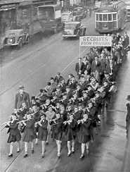 PH 13414. Enlisted men marching behind the drum and fife band, c.1940.