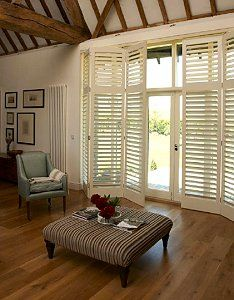 The Contemporary Solution to Screen French Windows...love this! I'd love this in the Master bedroom - it would complete that Caribbean - British Colonial look!