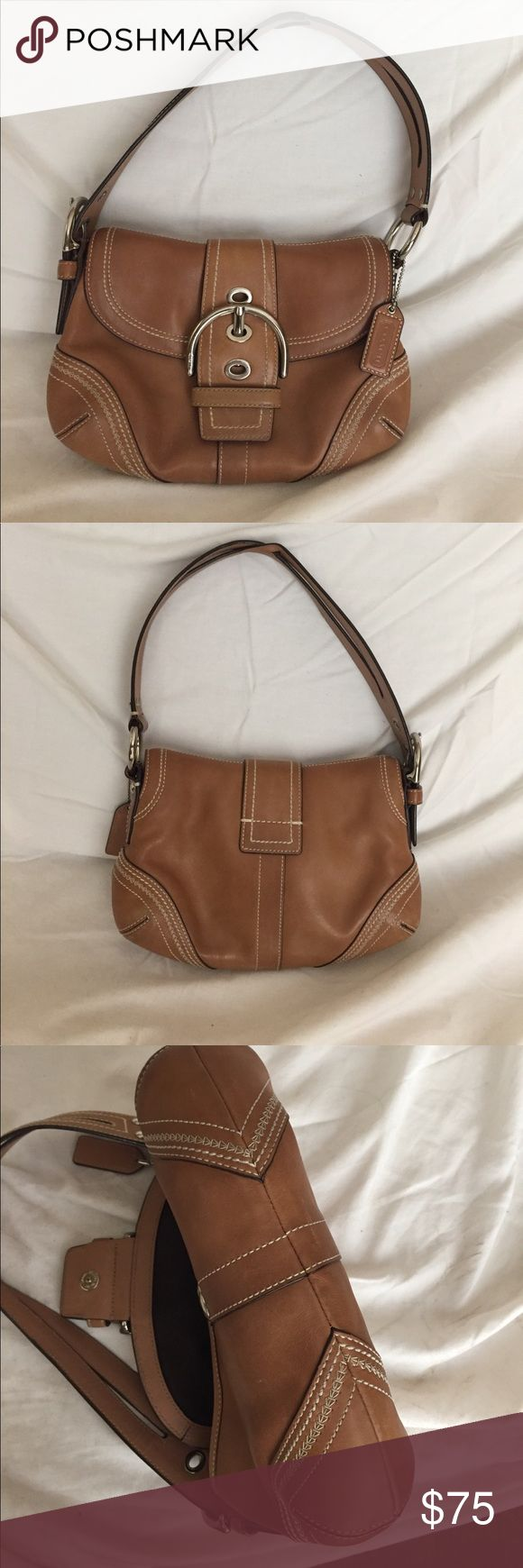 Coach Soho medium size handbag Gorgeous vintage camel colored so ho handbag from coach in excellent used condition. Purse has two main compartment's and a zippered pocket on the inside, silver hardware and signature stitching on the outside. This is a 100% genuine leather all leather quality well made handbag that will last a lifetime if cared for properly. It's beautiful and coordinates well with almost anything you might wear. Coach Bags Shoulder Bags