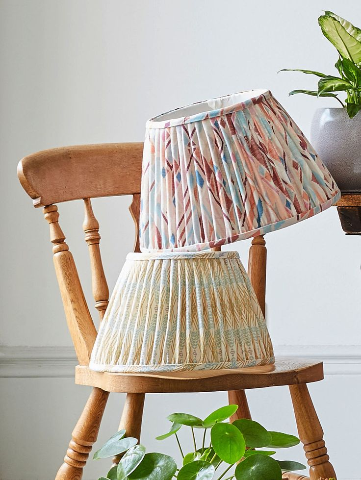 These Copper & Silk + A Rum Fellow lampshades are in Wawa and Zapora (Duck Egg Blue and Yellow).