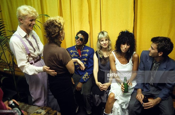 David Bowie backstage during his 'Serious Moonlight' tour with actress Bette Midler (second from left), Michael Jackson (centre, left) and Cher (second from right), 1983.