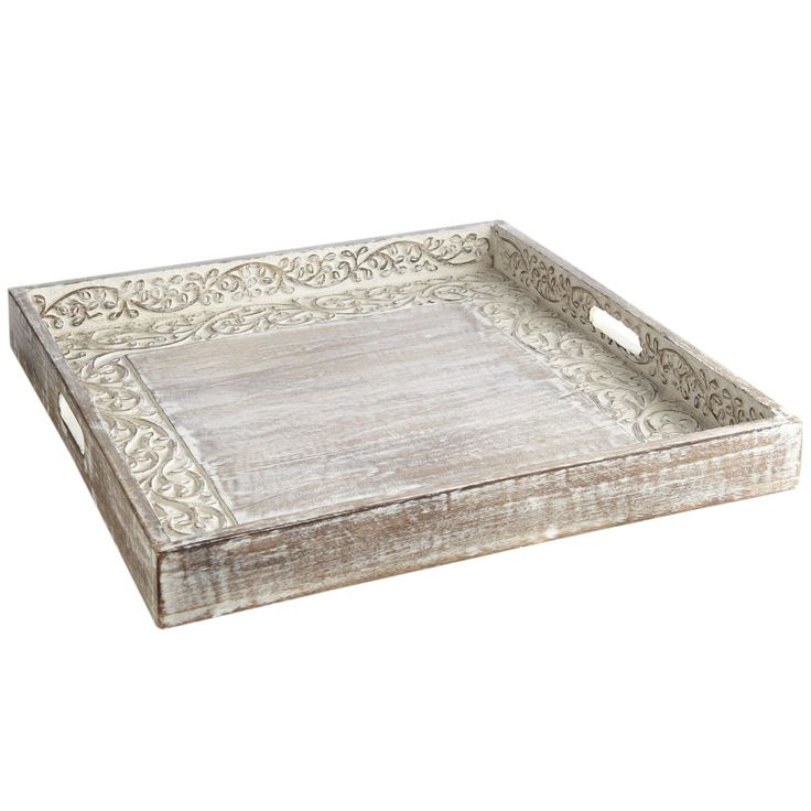 """Handcrafted from mango wood, our tray is whitewashed to show off its hand-gouged surface and finely chiseled vine pattern. A full 20"""" square, the tray functions exactly as intended in kitchens, dining and living areas, and as a global arts showpiece everywhere else."""