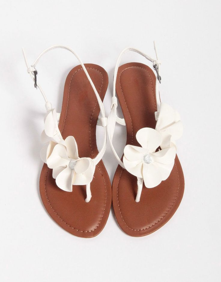 Perfect summer flats/sandals.  I'm over the gladiator sandal but still like that look, and this is a short enough departure from that to keep with that look yet is really different at the same time.