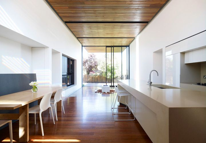 Contrasting ceiling and floor. Would probably opt for different materials for kitchen floor with timber ceiling.