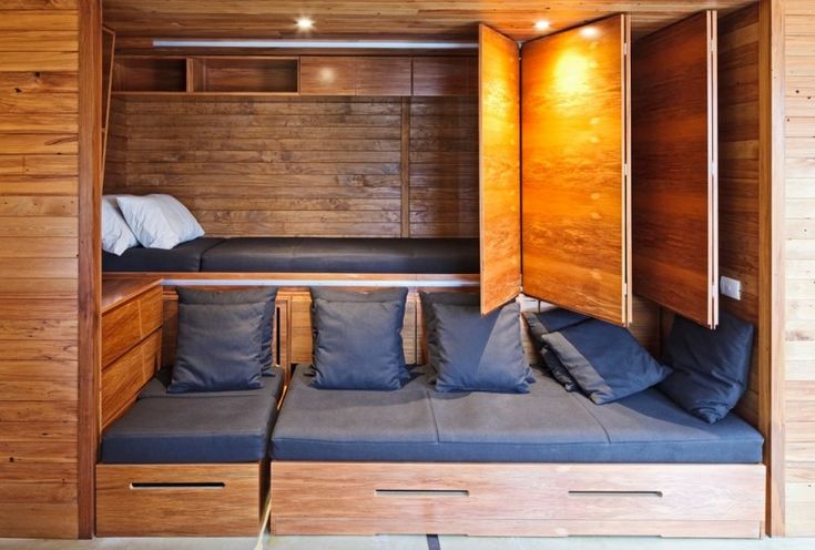 guest bed idea wooden walls pillows folding doors beach style bedroom ceiling lights of Clever Guest Bed Ideas to Try at Your Home
