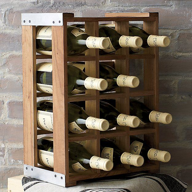Shop Case Wine Rack.  No-nonsense container racks up a case of wine in an acacia wood crate, embellished with rustic metal corners and our exclusive burned-in wine bottle logo.  Rack displays on its side or upright.
