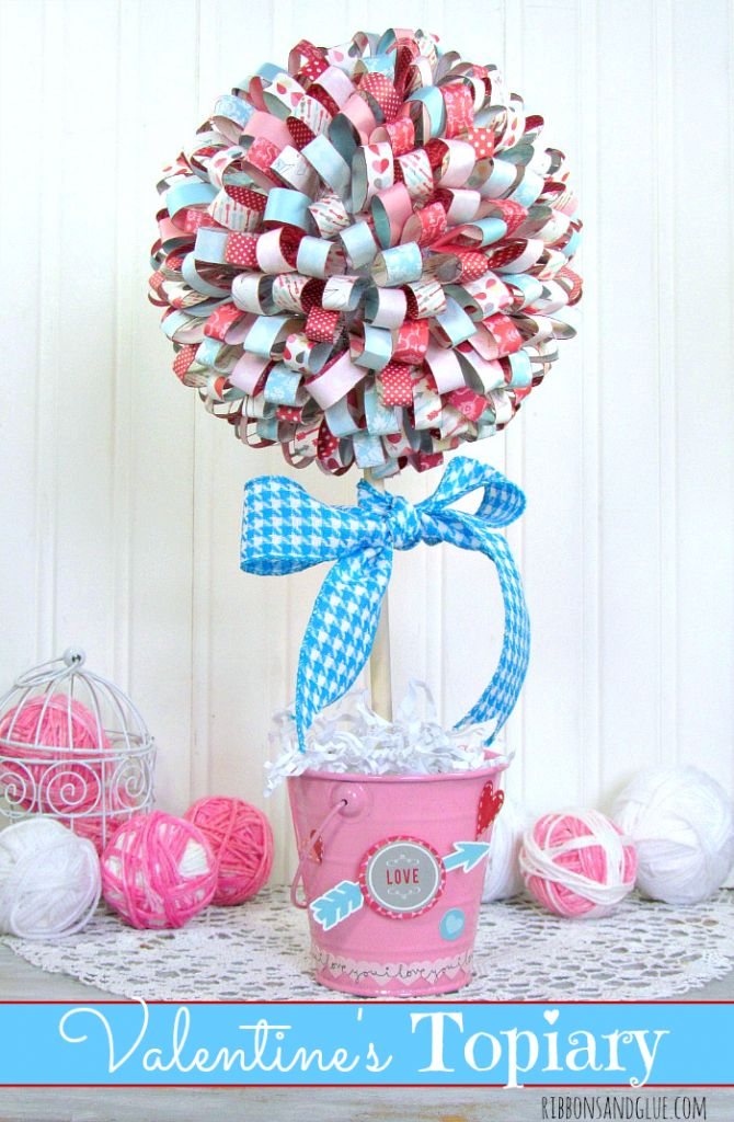 Valentine's Paper Ribbon Topiary. Tutorial on how to make paper ribbons out of scrapbooking paper then hot glue on to foam ball to make beautiful topiary.