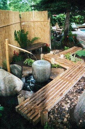 Asian-inspired. Bamboo panels, fountain, wooden walkways...