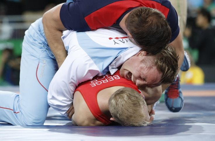 The moment of victory - Norwegian wrestler Stig-Andre Berge celebrates with his coaches after winning bronze in men's 59 kg Greco-Roman wrestling - Olympic Games, Rio de Janeiro