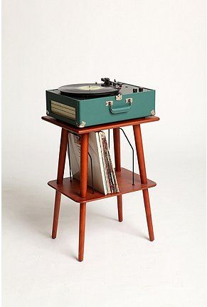 Record Player stand. Nice design but it's likely made from cheep wood and will fall apart under the weight of a real record player.