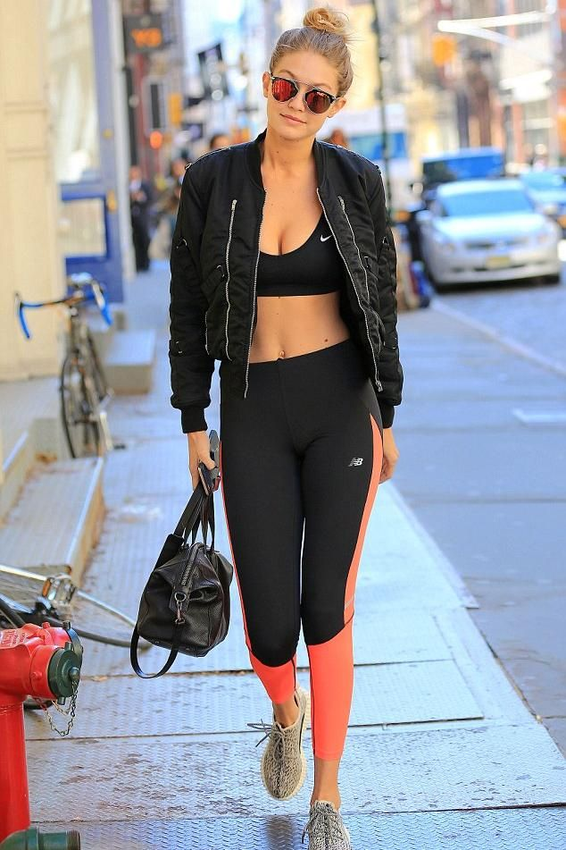 Gigi Hadid wearing New Balance Accelerate Tights, Elizabeth and James Scott Duffel Bag in Black