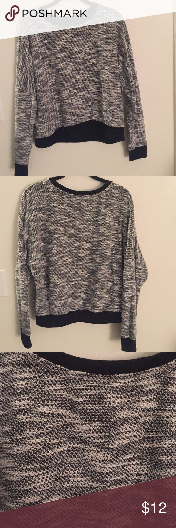Black and white crewneck sweater Like new black and white crewneck sweater, cool design, oversized ✨always open to offers✨ Tops Sweatshirts & Hoodies