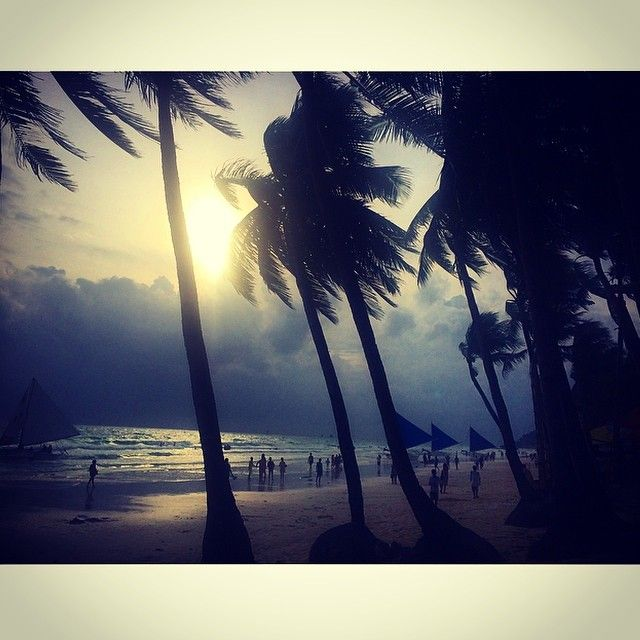 """""""She stood in the storm and when the wind did not blow her away she adjusted her sails.""""  #boracay #philippines #storm #sunset #palmtrees #beach #asia #island #travel #travilin #travelgram #travelling #gotd #mtgang #wanderlust #lonelyplanet #passionpassport #atmosphere #quotes #whitebeach #paradise by twoworldtravellers"""
