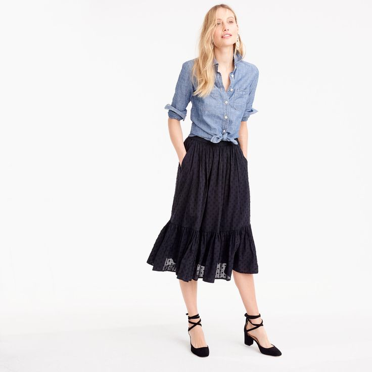 A swingy tiered skirt with an easy elastic back that pairs with slim-fitting tops or knotted oxford shirts. Cotton. Import.
