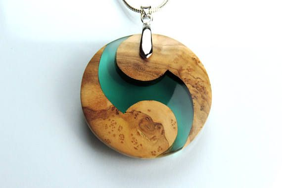 Yin Yang Pendant, Green Yin Yang, Green Pendant, Green Resin, Green Wood Resin, Green Necklace, Olive Wood Pendant, Wood and resin, Exotic Wood Necklace, Wood Resin, Resin Necklace, Olive wood Necklace, Pendant Olive wood and resin pendant made with green resin. A unique gift for a loved one. Shown with a silver plated chain, but also available with a black leather cord. The design of my wood and resin pendants start from an idea usually inspired by the shapes and colours in nature. Once…