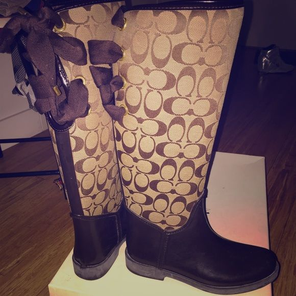 Brown Lace Up Coach Rain Boots Beautiful lace up Coach rain boots! They have brown suede inside the boot. So comfy and stylish! Coach Shoes Winter & Rain Boots