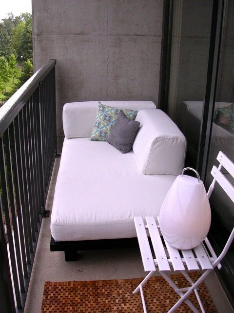Another cozy area to sit from 45 Cool Small Balcony Design Ideas | DigsDigs