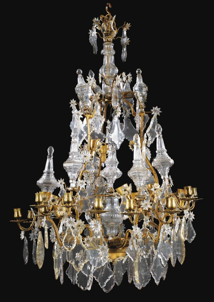 A VARNISHED-BRONZE CRYSTAL AND GLASS CHANDELIER, LOUIS XV STYLE