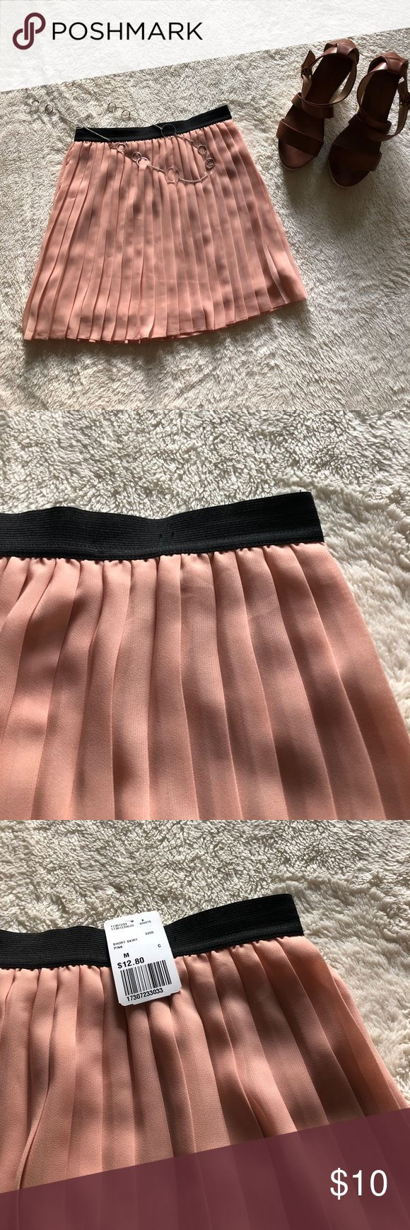 Forever 21 pink pleated Skirt! Size Medium! NWT! Fun, Flirty, and Pink forever 21 skirt! Great for a dirty date or a girls night out! Match with wedges or heals! Dress up for a club or dress down for a bbq!   The color is more of a blush or rust rose color!   This skirt is great because it has a lining!   100% Polyester. Forever 21 Skirts Mini
