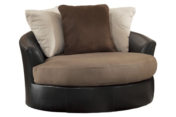 """The exciting two-tone contemporary design of the """"Masoli-Mocha"""" upholstery collection features soft upholstery fabric surrounding the plush supportive seat cushions beautifully accented by the brown faux leather upholstery adorned with stylish stitch details."""