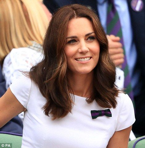Kate, who is royal patron of the All England club, wore a bow in Wimbledon colours pinned to her dress