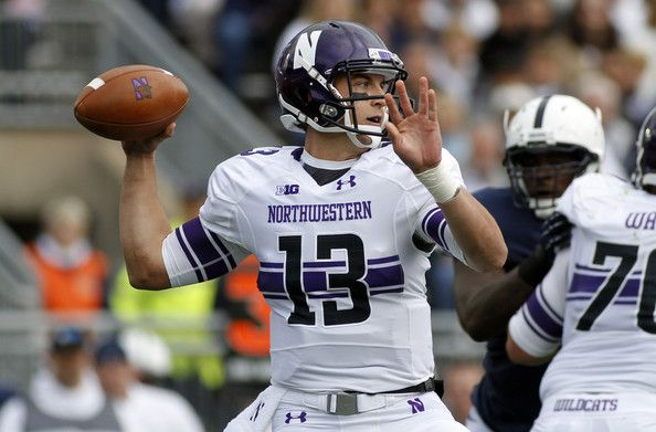 Trevor Siemian Photos Photos - Trevor Siemian #13 of the Northwestern Wildcats drops back to pass against the Penn State Nittany Lions during the game on October 6, 2012 at Beaver Stadium in State College, Pennsylvania. - Northwestern v Penn State