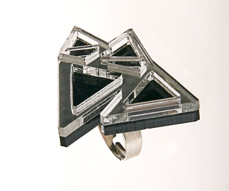 Amanda Loulou - Displèxia Jewellery @ www.fashionlover.gr ... Ring with linked triangles made of silver-mirror and black Plexiglas. A creation by Amanda Loulou - Displèxia Jewellery. Unique jewelry for your special appearances!