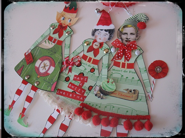 Paper Dolls. How cute to make one of these for each family member and hang together. Or even for wedding present