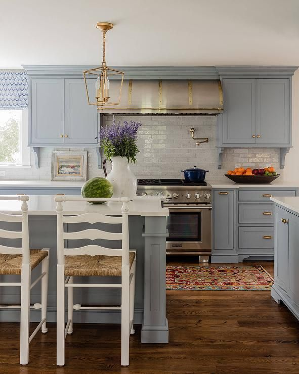 Feel Like Home In This Stunning Blue And White Kitchen Furnished With White  Ladder Back Rush