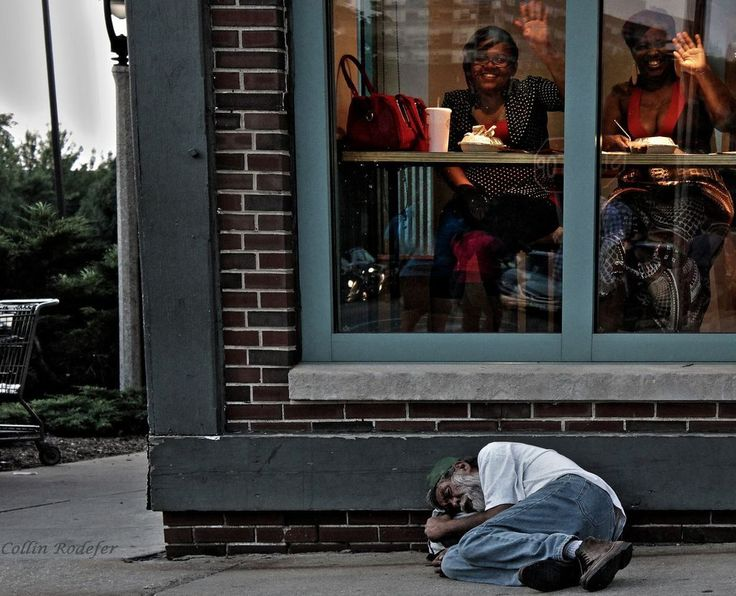 Ignorance is bliss - Homeless man sleeps outside a diner in Milwaukee.