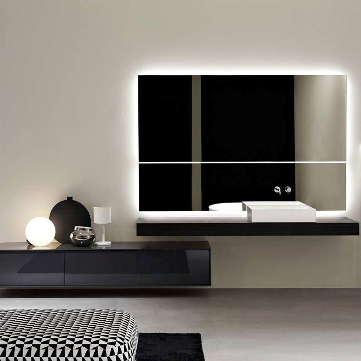 Zarif ve uyumlu bir şekilde iki farklı ruhu birleştiren bir lavabo. Tasarım Mario Ferrarini A washbasin that combines two different souls in an elegant and harmonious way. Design by Mario Ferrarini