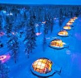 Finland! Hotel Kakslauttanen offers rooms that are thermal igloos made of glass so you can view the Northern Lights.