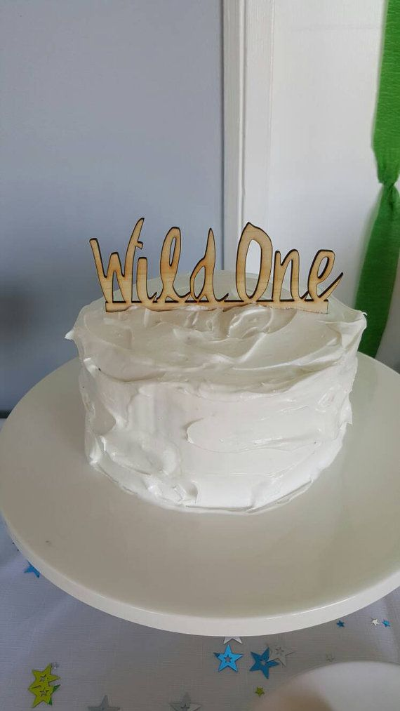 A small WILD ONE cake topper from Katrina Louise Designs. The perfect topper for a first birthday cake.