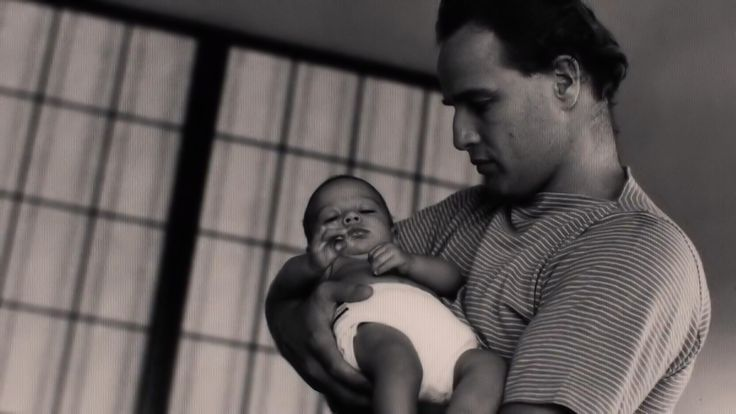 """thebrandos: """"A Candid of Marlon Brando and son Christian Devi Brando C.1958. """"In a long conversation about acting in the early 1980s, Brando told Michael Jackson: """"The day Christian [Brando's first..."""