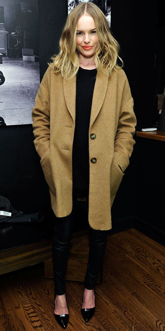 Kate Bosworth feted the Sundance Film Festival in a black ensemble that she topped off with a camel coat.